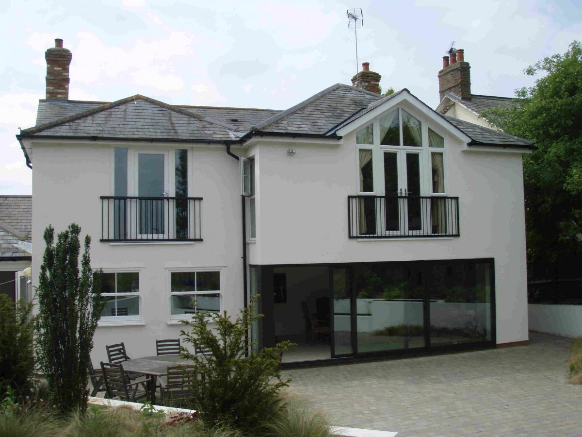 Two storey extension glass wall